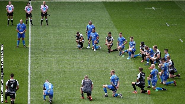 Ospreys and Cardiff Blues players mark rugby against racism before the 20-20 draw at the Liberty Stadium