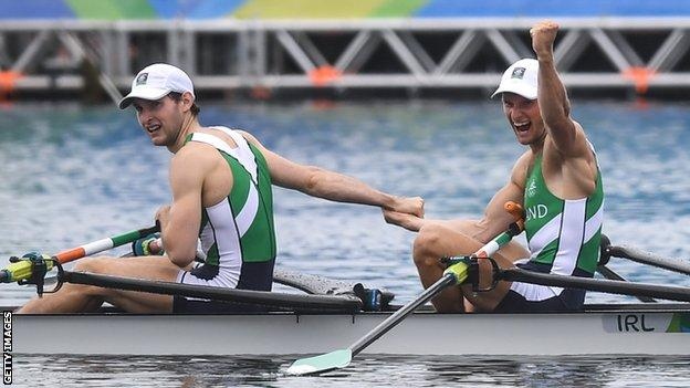Gary O'Donovan (right) celebrates and he and his younger brother Paul clinch a lightweight double sculls silver medal in Rio