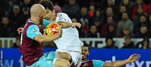 James Collins throws his body at the ball to block Ki Sung-yueng's goal-bound effort