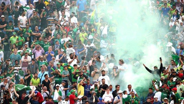 Pakistan fans let off a flare after they beat Afghanistan