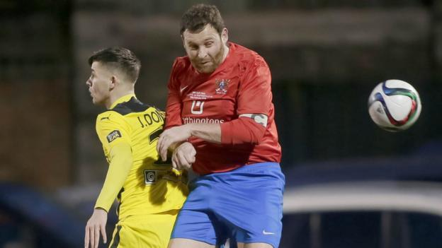 Jay Donnelly and Ards captain James Cully in action during the second domestic cup final of the season