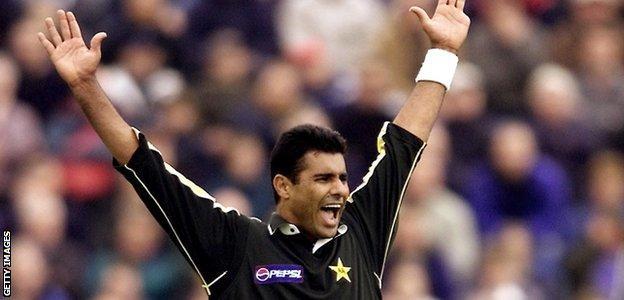 Waqar Younis celebrates taking a wicket