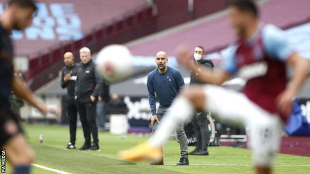 Pep Guardiola looks on during Manchester City's 1-1 draw at West Ham