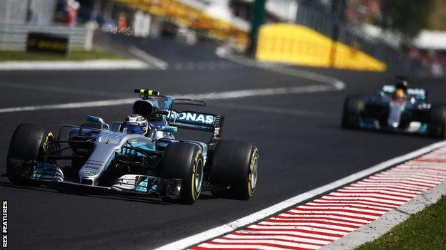 Mercedes F1 drivers Valtteri Bottas (front) and Lewis Hamilton