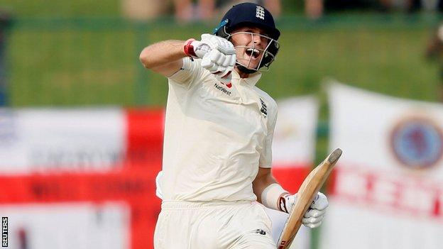 England captain Joe Root punches the air in celebrations after reaching his century against Sri Lanka