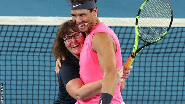 Rafael Nadal with a female firefighter