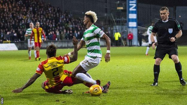 Scott Sinclair is brought down in the box by Mustapha Dumbuya