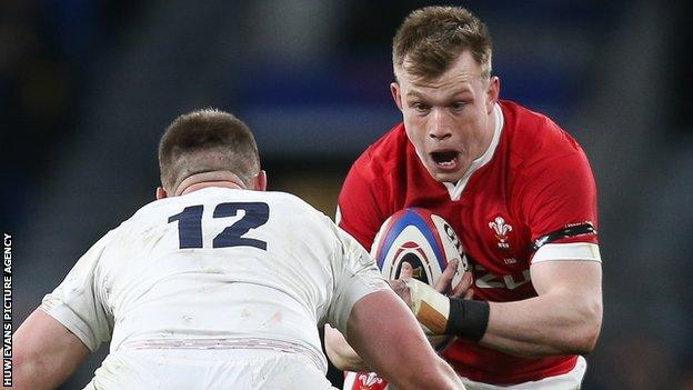 Wales' Nick Tompkins (right) takes on England captain Owen Farrell