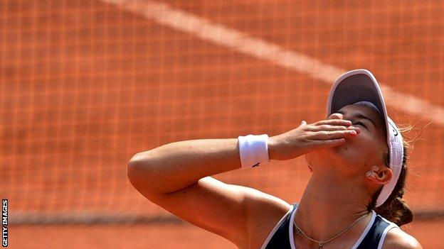 Barbora Krejcikova looks up to the sky after winning the French Open title