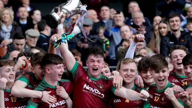 St Ronan's Jamie Haughey lifts the trophy after his school's one-point victory in Dublin
