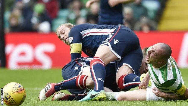 Ross County's Andrew Davies was sent off for a stamp on Scott Brown