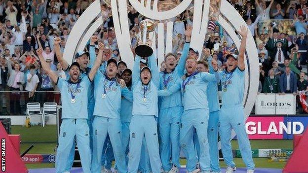 England captain Eoin Morgan holds the World Cup trophy aloft
