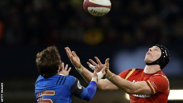 Liam Williams and Maxime Medard challenge for a high ball