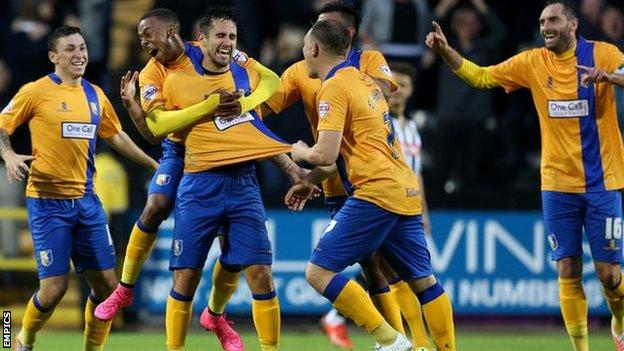 Mansfield Town players celebrate Chris Clements's first-half goal