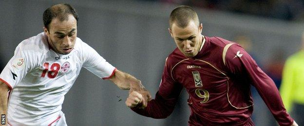 Kenny Miller (right) was in action for Scotland in 2007