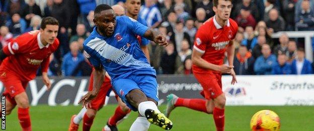 Hartlepool's Kudus Oyenuga scores from he penalty spot in the game against Leyton Orient