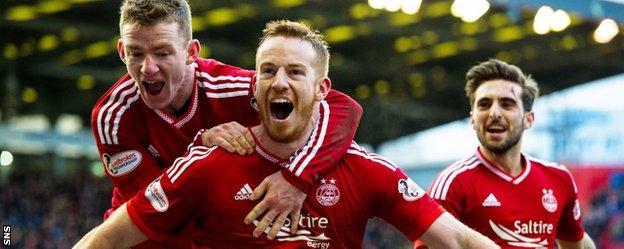Aberdeen's Jonny Hayes, Adam Rooney and Graeme Shinnie celebrate