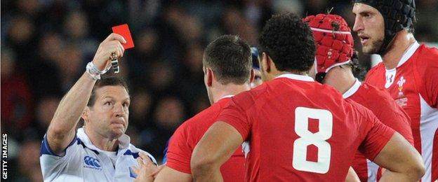 Alain Roland issues a red card to Sam Warburton during the 2011 World Cup semi final in Auckland