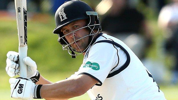 Jonathan Trott's 137th first-class half-century helped him go past 12,000 runs for Warwickshire