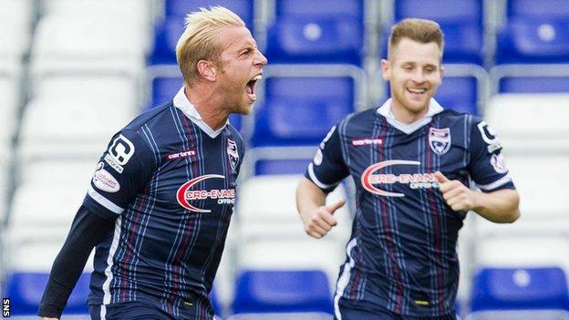 Andrew Davies roars after scoring Ross County's second