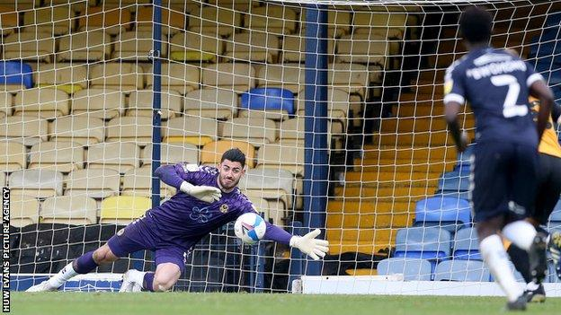 Tom King made a fine save from Matt Rush's penalty