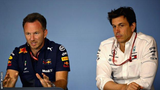 Red Bull team principal Christian Horner (left) and Mercedes F1 boss Toto Wolff (right) speaking at a news conference