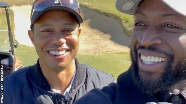 Tiger Woods (left) and Dwyane Wade