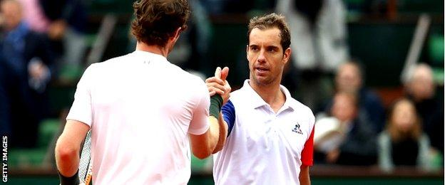 Andy Murray shakes hands with Richard Gasquet