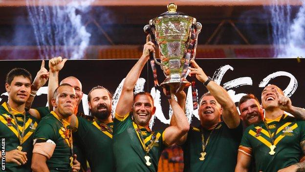 Australia players celebrate with the trophy after winning the 2017 men's Rugby League World Cup