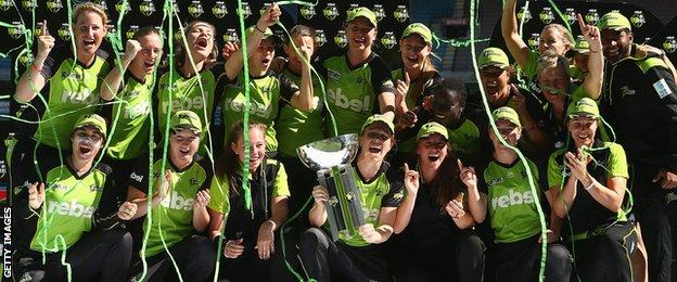 Sydney Thunder celebrate with the WBBL trophy