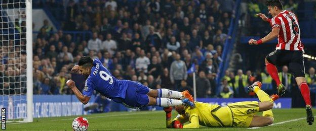 Chelsea striker Radamel Falcao goes to ground as he is challenged by Southampton keeper Martin Stekelenburg