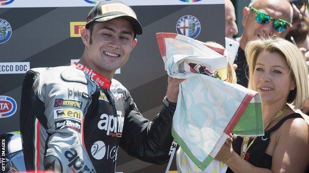 Leon Haslam celebrates his podium finish in Misano