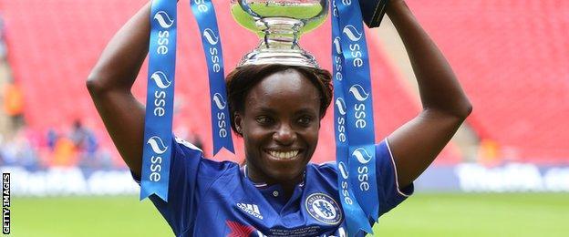 Eniola Aluko lifts the FA Cup