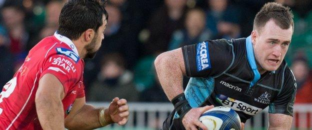 Glasgow's Stuart Hogg (right) in action against Scarlets
