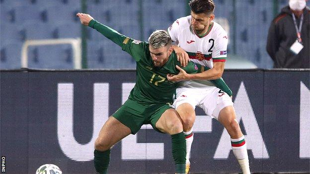Aaron Connolly battles with Bulgaria's Ivelin Popov