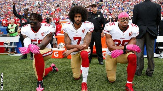 Colin Kaepernick (centre) first took the knee in September 2016