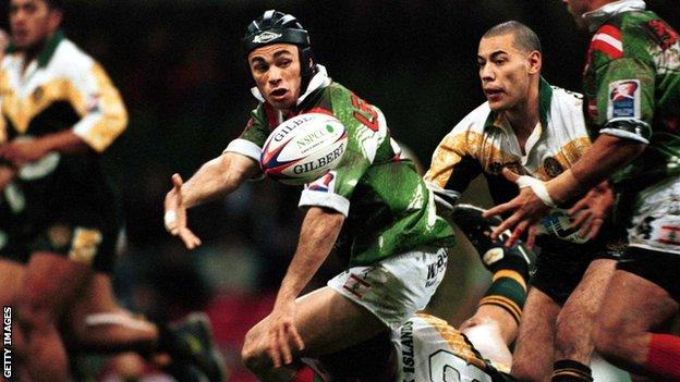 Travis Touma of Lebanon offloads during the 2000 Rugby League World Cup match against Cook Islands in Cardiff