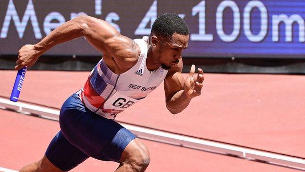 CJ Ujah running in the men's 4x100m relay in Tokyo