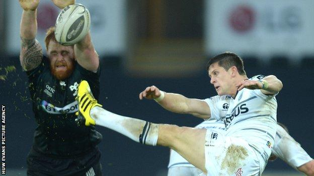 Lloyd Williams (right) has a kick charged down by Dan Baker during Cardiff Blues' defeat to Ospreys