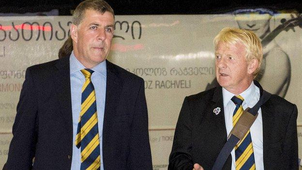 Scotland assistant manager Mark McGhee and manager Gordon Strachan arrive at Tbilisi airport