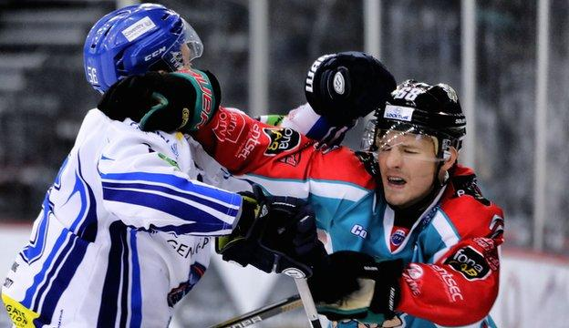 Coventry's Kevin Noble trades blows with Chris Higgins of the Belfast Giants