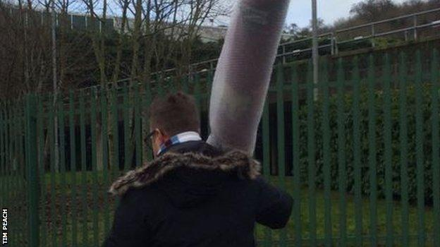 We still don't, however, know why this football fan was making his way to Wycombe's Adams Park with a roll of carpet...
