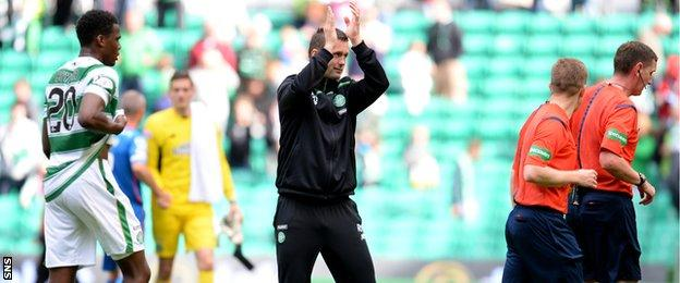 Celtic manager Ronny Deila applauds the home fans