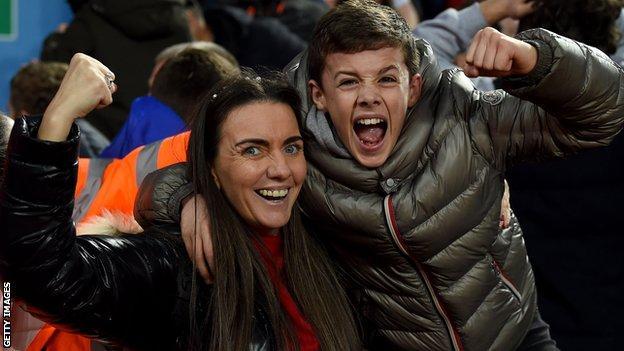 Liverpool fans celebrate their win over Aston Villa