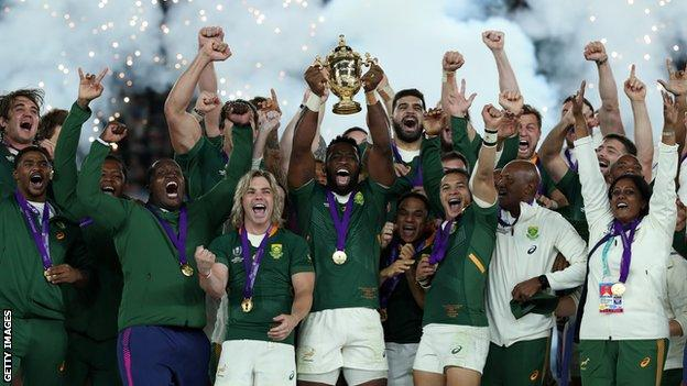 South Africa celebrate with the World Cup trophy