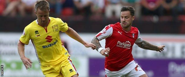 MK Dons goalscorer Dean Bowditch is challenged by Rotherham United's Chris Maguire