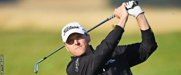 Michael Hoey plays an iron shot in Denmark on Friday