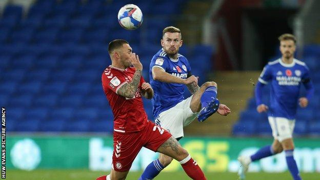 Joe Ralls and Jack Hunt challenge for the ball