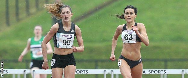 Jess Turner (left) battles with Christine McMahon in the women's 400m hurdles