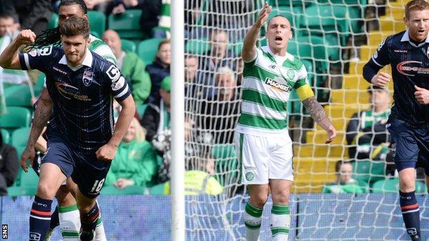 Celtic captain Scott Brown complains as Ross County goal-scorer Stewart Murdoch celebrates